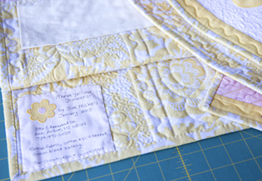 Sue Nickels teaches you to block and trim your quilt and how to add straight double binding with mitered corners and join the binding for a clean join.