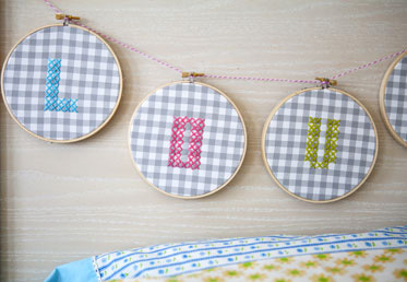 "Cross-stitch will appeal to new generations of crafters with Annabel Wrigley's modern and feminine take on this classic. Oversized gingham makes a natural ""map"" to follow when creating the stitches, and bright embroidery floss ups the cool factor."
