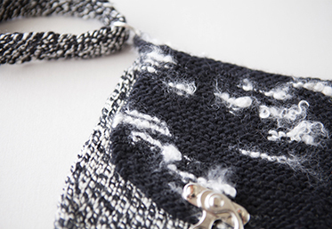 Knit  Crossbody Clutch: Cirilia Rose teaches an easy way to do a provisional cast on, how to create the body of the bag in the round and attaching the metal closures.