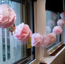 Pink pom pom garland for a baby shower. Small paper cut-outs of cute animals pinned between pom poms. Coffee filters dyed with RIT Liquid Dye in