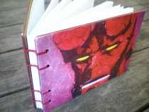 My dad painted the Hellboy and I turned it into a journal.  I was able to learn the 2 needle method watching Jody's class and was able to apply the technique to do a 4 needle binding.