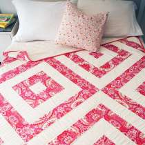 Heather Jones shows you how to cut and strip piece fabric and then cut them into blocks. She also talks about how to work with bias cut edges to minimize stretch.