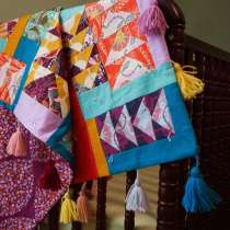 Anna Maria Horner puts a fresh spin on the traditional Flying Geese design with this baby quilt. She explains how she chooses solid and prints, lights and darks, and how she pairs different prints to add depth and pop to each block.