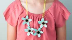 Annabel Wrigley shows you how to make this children's craft project. This kids summer crafts for kids project will teach you how to make a paper flower necklace using Cricut Explore.