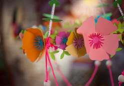 Annabel Wrigley teaches you with your child how to cut out flowers and vines using a Cricut Explore machine. Learn to make paper flowers in this children's crafting project.