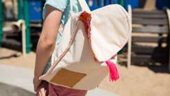 Annabel Wrigley teaches you how to make a backpack in this crafts for kids project. In this kids arts and crafts class you'll be able to cut and stitch this DIY backpack for kids.