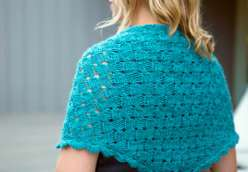 Fancy Tiger Crafts show you how to make a great knitting project with The Imposter's Shawl. This hand made triangular shawl has basket weave stitches and scalloped edging appear to be woven and crocheted – but, in fact, it's all cleverly knitted.