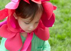 Courtney Cerruti teaches cutting out felt petals and giving them a cupped shape to create a head piece. This is a great homemade Halloween costume idea for kids.