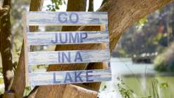 Make a summertime sign using a wooden palette perfect for lake house or cabin decor.