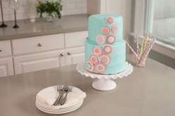 Emily Tatak of Wilton teaches how to use fondant to create a smooth finish on a stunning tiered cake in this baking and cake decorating class.  Come decorate cakes with color fondant to cover a two-tiered stacked cake.