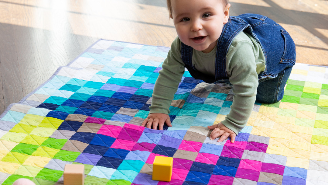 Perfectly Pixelated Jelly Roll Quilt by Ashley Nickels