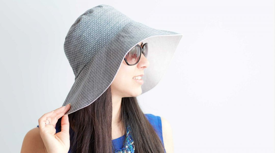 A day in the sun is fun and relaxing, but it's important to protect your skin and a sun hat with a large brim is a great way to do that! Make your own reversible sun hat with this free easy sewing pattern in .