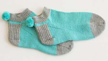 Knitting Patterns Footie Socks : Knitted Pom Pom Socks by Wendy Bernard - Creativebug